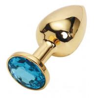 Золотистая металлическая анальная пробка с голубым стразом